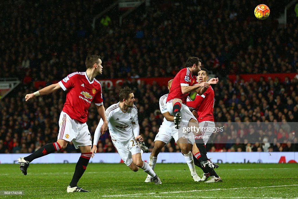 Gylfi Sigurdsson of Swansea City heads the ball to score his team's first goal during the Barclays Premier League match between Manchester United and Swansea City at Old Trafford on January 2, 2016 in Manchester, England.