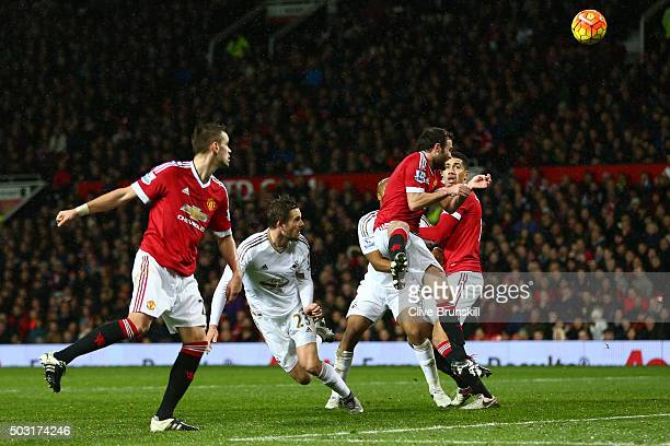 Gylfi Sigurdsson of Swansea City heads the ball to score his team's first goal during the Barclays Premier League match between Manchester United and...