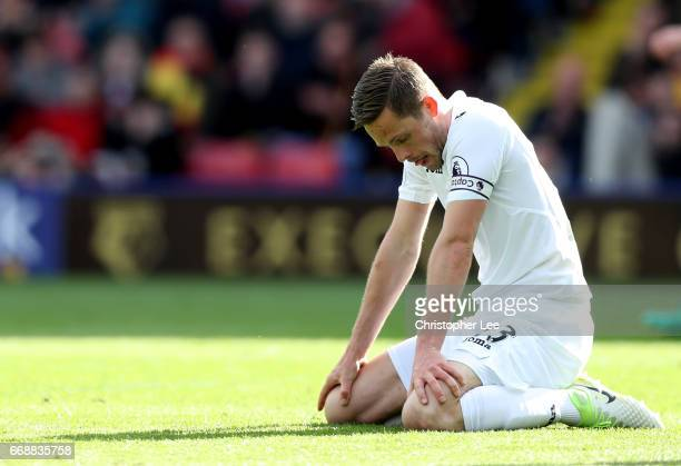 Gylfi Sigurdsson of Swansea City is dejected after the Premier League match between Watford and Swansea City at Vicarage Road on April 15 2017 in...