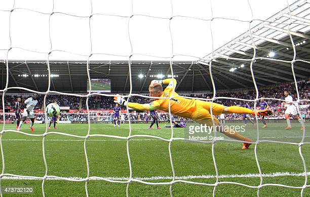 Gylfi Sigurdsson of Swansea City scores a goal past the outstretched Joe Hart of Manchester City during the Barclays Premier League match between...