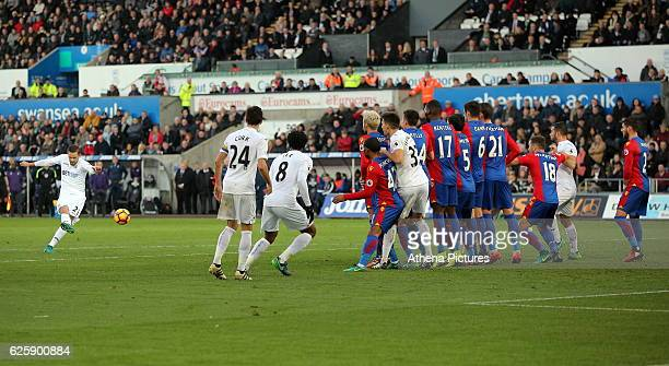 Gylfi Sigurdsson of Swansea City scores his equaliser with a free kick during the Premier League match between Swansea City and Crystal Palace at The...
