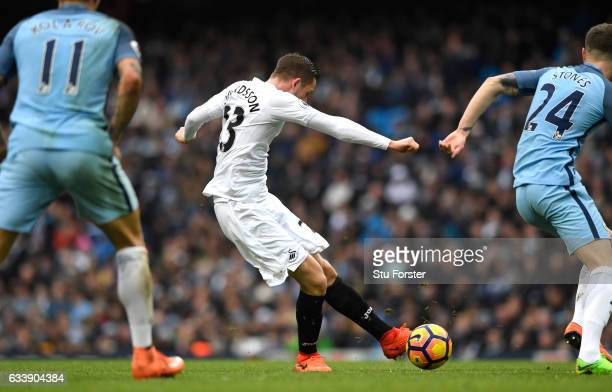 Gylfi Sigurdsson of Swansea City scores his sides first goal during the Premier League match between Manchester City and Swansea City at Etihad...