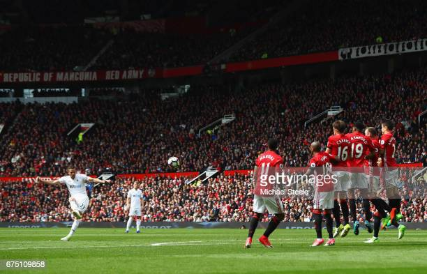 Gylfi Sigurdsson of Swansea City scores his sides first goal from a freekick during the Premier League match between Manchester United and Swansea...