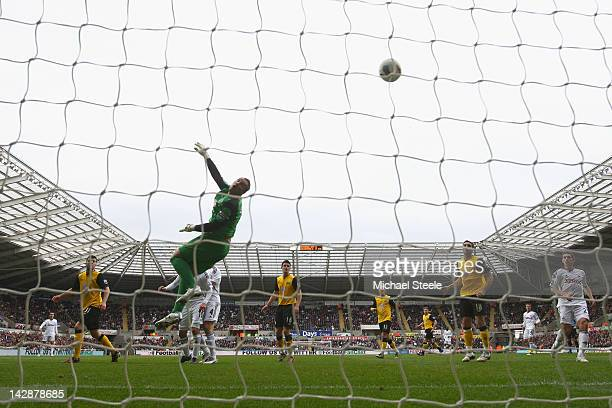 Gylfi Sigurdsson of Swansea City scores his sides first goal past a diving Paul Robinson of Blackburn Rovers during the Barclays Premier League match...