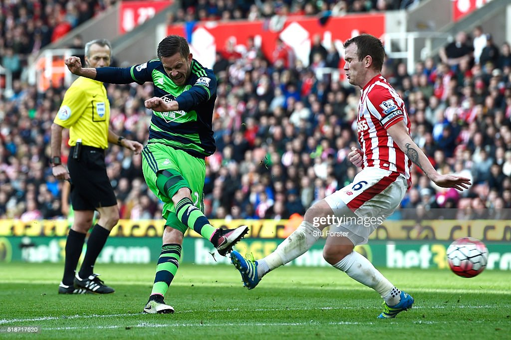 Gylfi Sigurdsson of Swansea City scores his team's first goal during the Barclays Premier League match between Stoke City and Swansea City at Britannia Stadium on April 2, 2016 in Stoke on Trent, England.