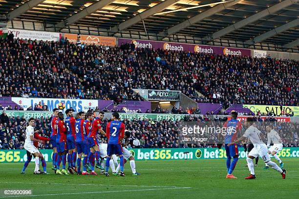 Gylfi Sigurdsson of Swansea City scores his team's first goal from a free kick during the Premier League match between Swansea City and Crystal...