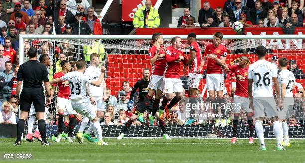 Gylfi Sigurdsson of Swansea City scores their first goal during the Premier League match between Manchester United and Swansea City at Old Trafford...