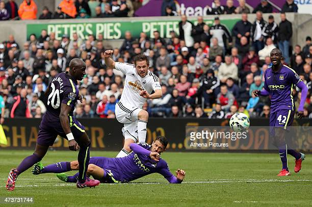 Gylfi Sigurdsson of Swansea scores during the Premier League match between Swansea City and Manchester City at The Liberty Stadium on May 17, 2015 in...