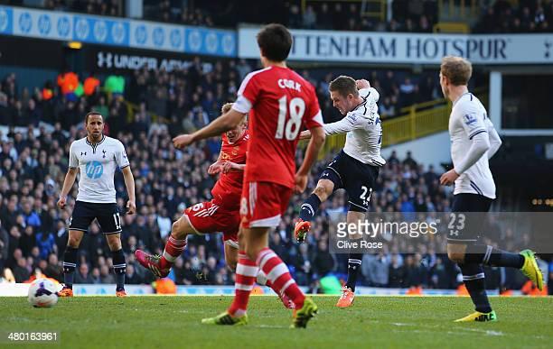 Gylfi Sigurdsson of Tottenham Hotspur scores his team's third goal during the Barclays Premier League match between Tottenham Hotspur and Southampton...