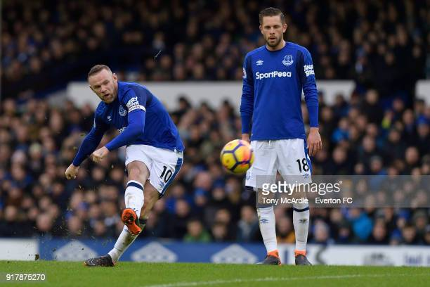 Gylfi Sigurdsson watches Wayne Rooney take a free kick during the Premier League match between Everton and Crystal Palace at Goodison Park on...