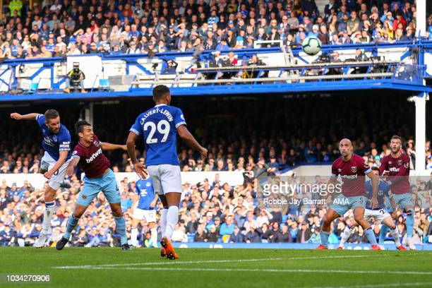 Gylfi Sigurosson of Everton scores a goal to make it 12 during the Premier League match between Everton FC and West Ham United at Goodison Park on...