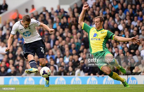 Gylfi Sigurosson of Spurs scores the opening past Steven Whittaker of Norwich City during the Barclays Premier League match between Tottenham Hotspur...