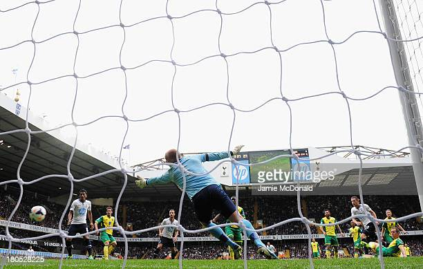 Gylfi Sigurosson of Spurs scores their first goal past John Ruddy of Norwich City during the Barclays Premier League match between Tottenham Hotspur...