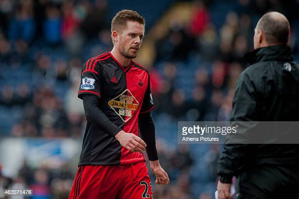 Gylfi Sigurosson of Swansea City leaves the field after being sent off during the FA Cup Fourth Round match between Blackburn Rovers and Swansea City...