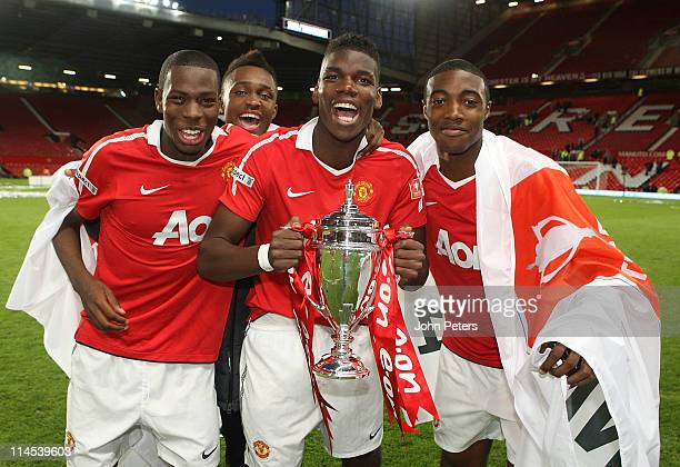 Gyliano van Velzen Paul Pogba and Tyler Blackett of Manchester United Academy Under18s celebrate with the FA Youth Cup trophy after the FA Youth Cup...