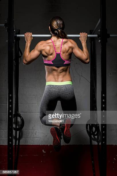 gym athlete doing chin-ups