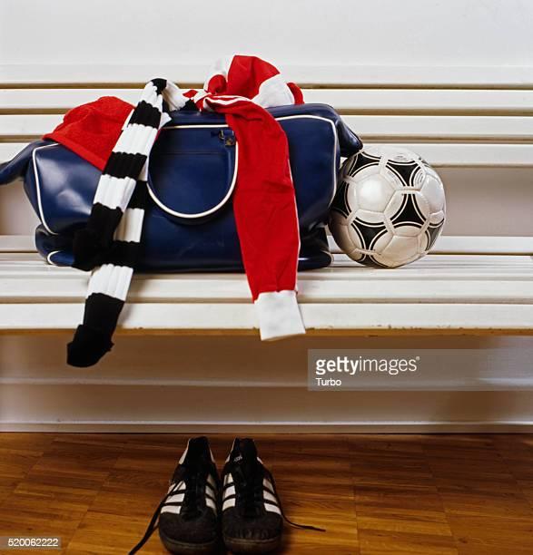 Gym Bag and Ball on Bench