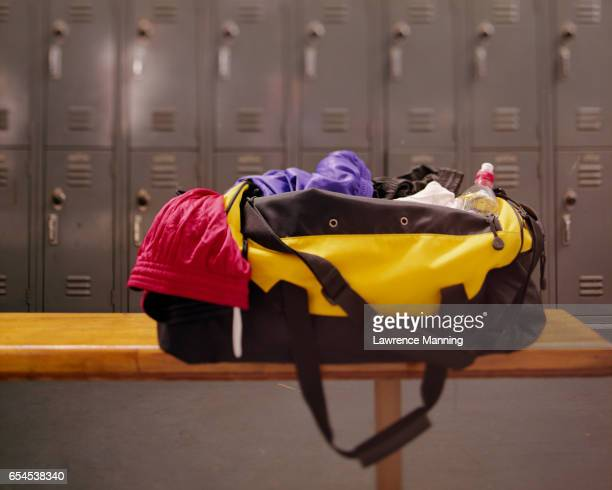 gym bag resting on bench - gym bag stock pictures, royalty-free photos & images