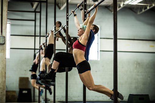 gym - class doing pull ups - gettyimageskorea