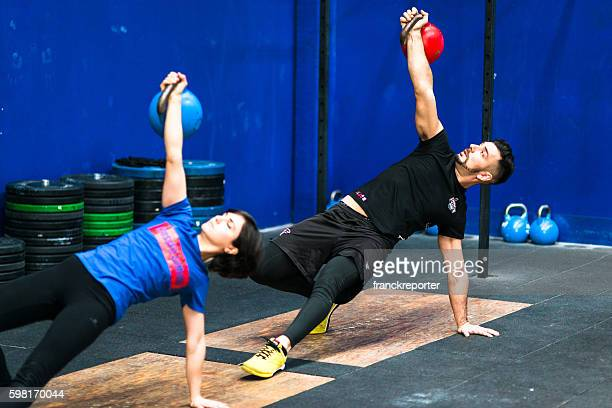 gym class lifting a kettlebell