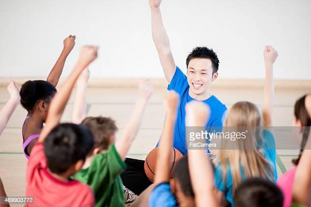 gym class with teacher - pe teacher stock photos and pictures