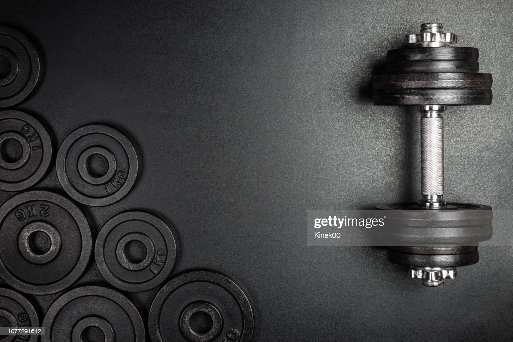 Gym dumbbells with black metal weights 1kg and 2kg on black background with copy sapce, Photograph taken from above. : Stock Photo