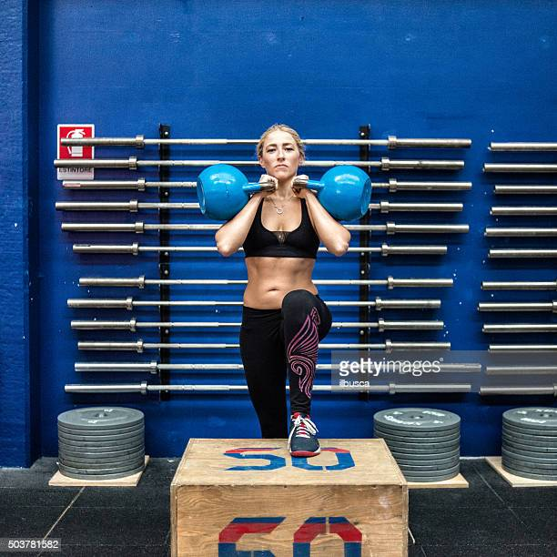 Gym fitness workout: box jump and kettle bells