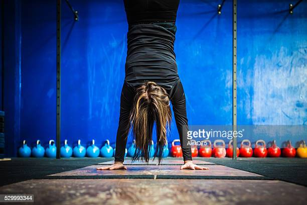 Gym fitness workout: Woman doing a handstand