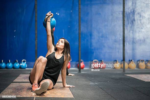 Gym fitness workout: Woman with kettle bell