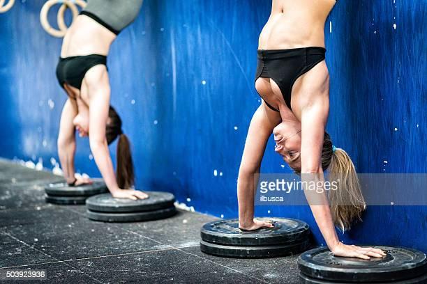Gym fitness workout: Women handstand