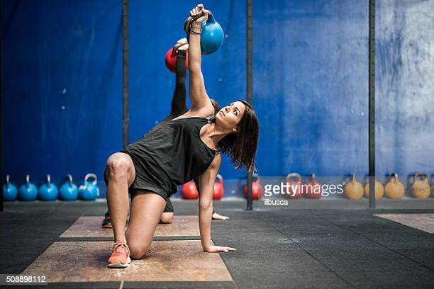 gym gym workout: kettle bell class - crossfit stock pictures, royalty-free photos & images