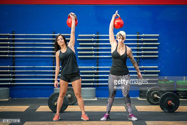 gym gym workout: Women with kettle bells