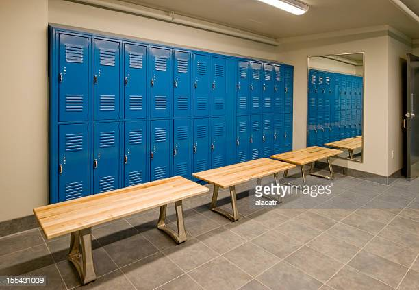 gym locker room with wooden benches and blue lockers - locker room stock pictures, royalty-free photos & images
