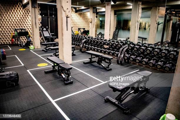 Gym machines seen placed within a one and a half meter social distance due to coronavirus. One and a half meter social distance adjustments are made...