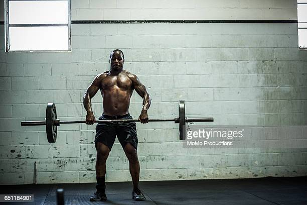 gym - man lifting weights - running shorts stock pictures, royalty-free photos & images