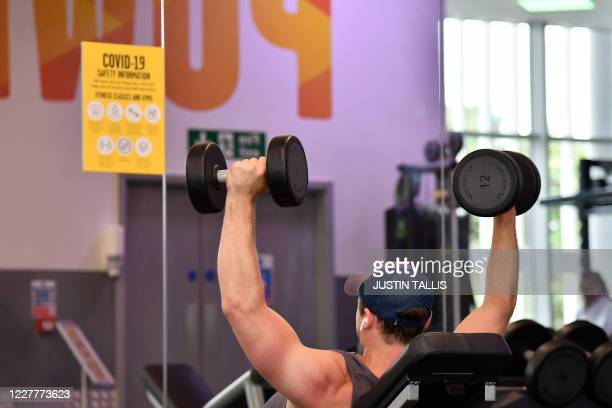 A gym member exercises at Kensington Leisure Centre in west London on July 25 2020 as novel coronavirus lockdown restrictions are eased to allow gyms...