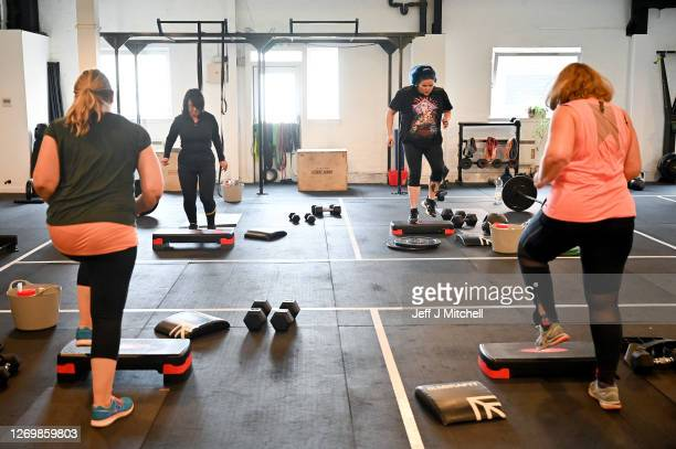 Gym members at Strong Like a Mutha take part in a fitness class on August 31, 2020 in Glasgow, Scotland. Indoor gyms and pools were closed for almost...