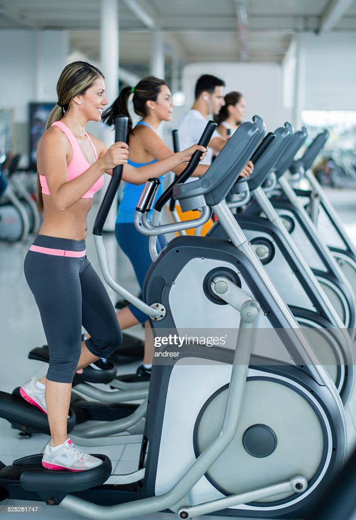 Gym people on cross trainers : Stock Photo
