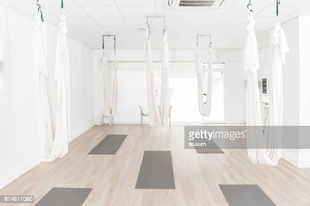 gym prepared for aerial yoga classes - yoga studio stock pictures, royalty-free photos & images