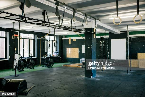 a gym scene with various equipment - palestra club ginnico foto e immagini stock