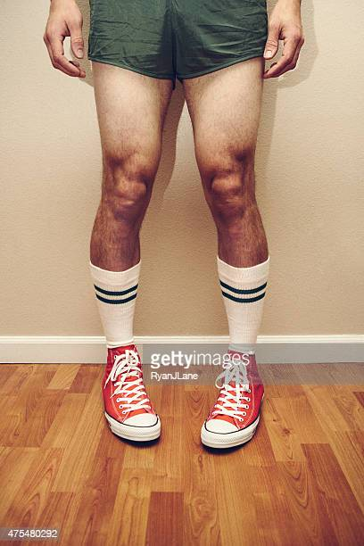 gym style retro man - running shorts stock pictures, royalty-free photos & images