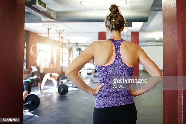 gym time is go time - hand on hip stock pictures, royalty-free photos & images