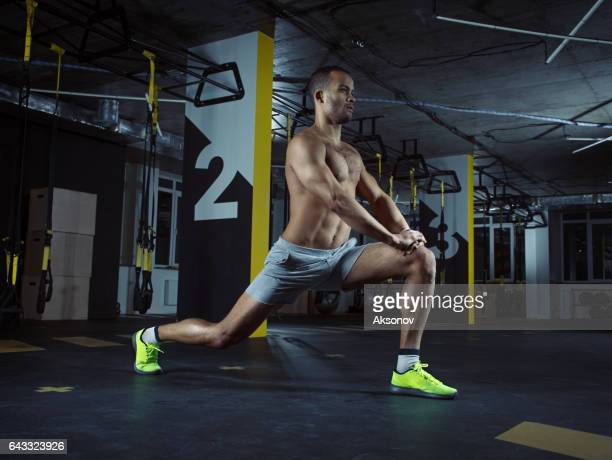 Gym training: Male athlete in action