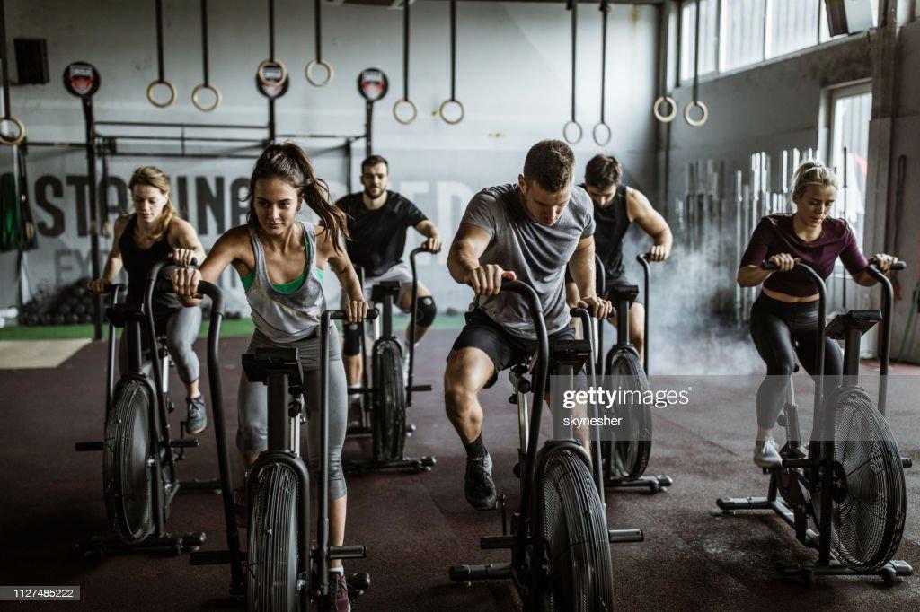 gym training on stationary bikes! : Stock Photo