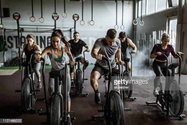 gym training on stationary bikes! - crossfit stock pictures, royalty-free photos & images