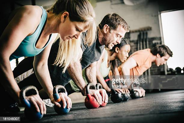 gym training push ups - crossfit stock pictures, royalty-free photos & images