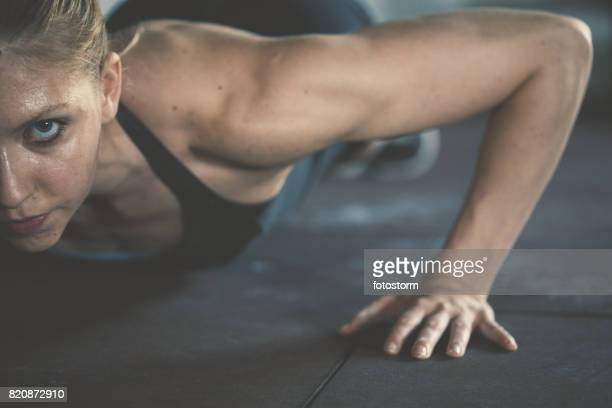 gym woman exercising in gym - center athlete stock pictures, royalty-free photos & images
