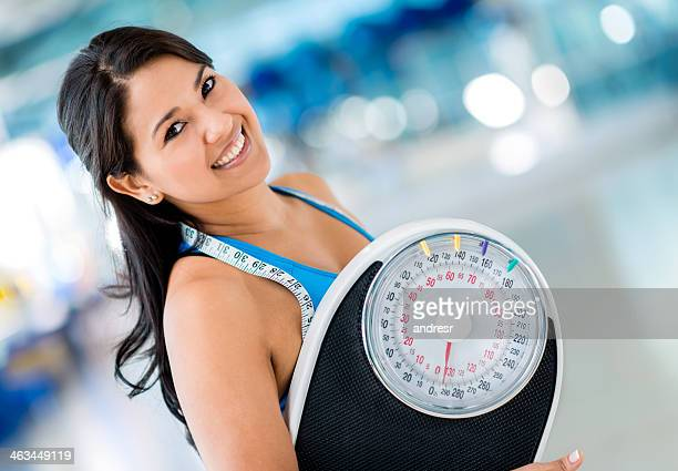 gym woman holding a scale - kilogram stock pictures, royalty-free photos & images