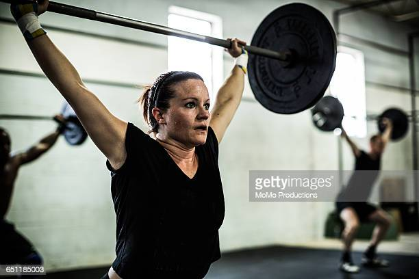 gym - woman lifting weights