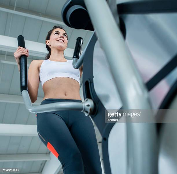 Gym woman on the cross trainer